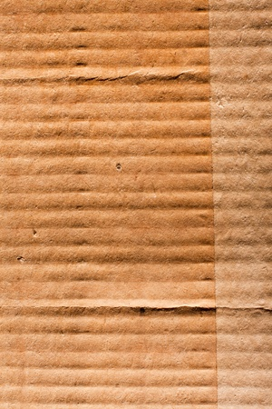 Textured recycled cardboard with natural fiber parts  Stock Photo - 13402624