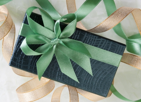 Gift decorated with a tape and a bow photo