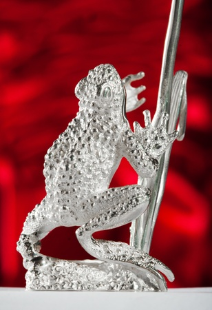 ionizer: Silver sculpture of a frog. Stock Photo