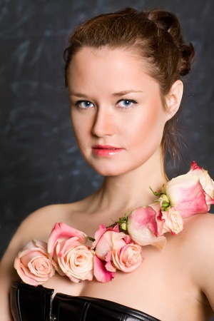 The elegant caucasian young girl against from rose Stock Photo - 9382842