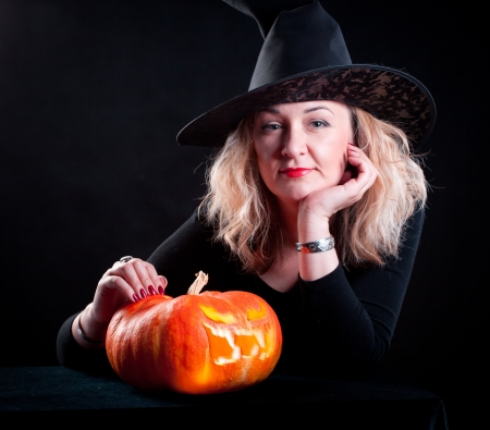 steam mouth: The charming witch cooks the potion on the eve of Halloween  Stock Photo