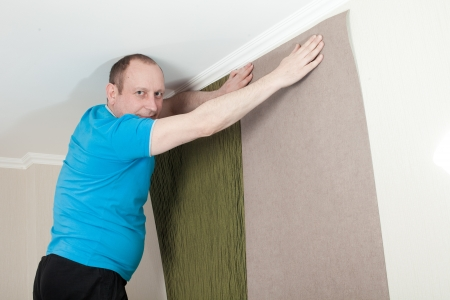 The master repairs the room in the apartment Stock Photo