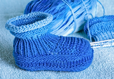 bootees: knitting of bootees for the newborn Stock Photo