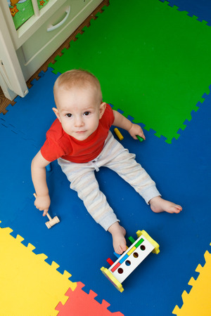 plays: baby plays in a nursery