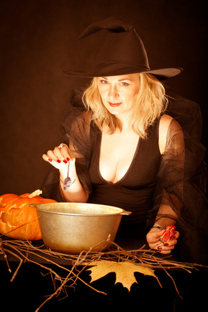 terribly: witch conjures in Halloween