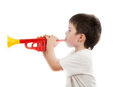 young musician: Young musician plays the solo on trumpet Stock Photo