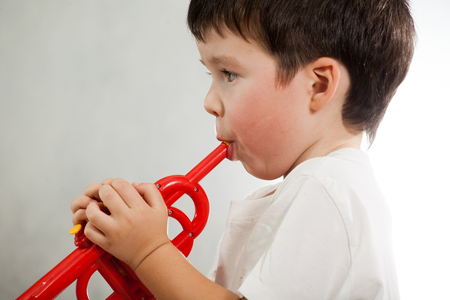 Young musician plays the solo on trumpet 写真素材