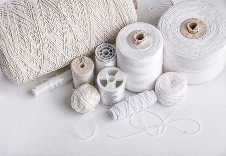 cotton thread for sewing, wound on a wooden spool, vintage, on white background