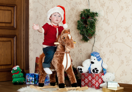 Baby boy playing with a rocking horse