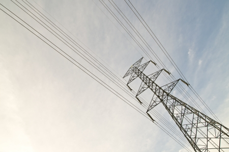 electric high voltage post with sky background photo