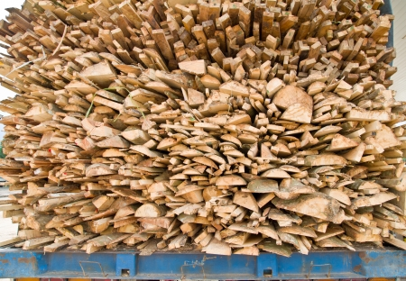logging truck: a wooden logs on logging truck trailer Stock Photo
