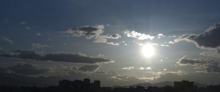 iluminate: Panoramic view of sunset in the city Stock Photo