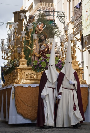 Couple of penitents with a Holy Week image during a procession in Jumilla  Spain  Editorial
