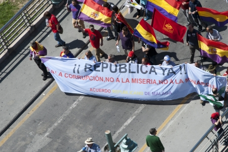 the monarchy: Several people participates in the demonstration in Malaga against Monarchy during the anniversary of the II Spanish Republic