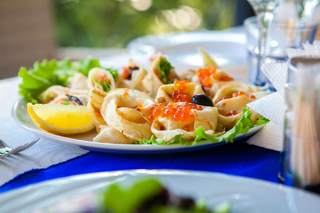 ensaladilla rusa: The dish in the restaurant - roll with red caviar.