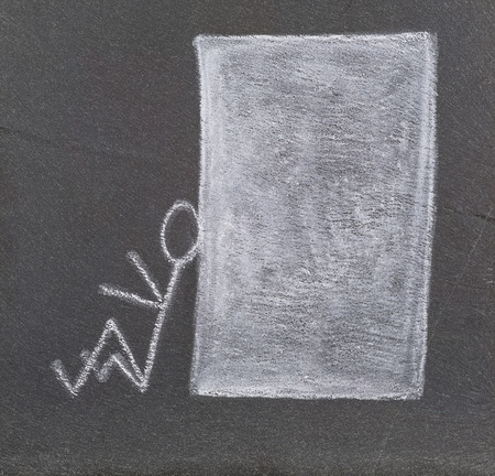 A stick figure leaning on a big white block, drawn with a plate of slate  photo