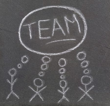 think tank: Some stick figures thinking together drawn on a plate of slate  Stock Photo
