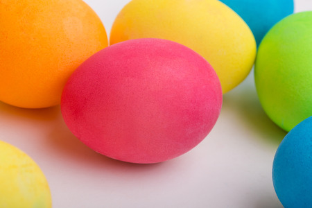 dyeing: A set of colored easter eggs on a white background