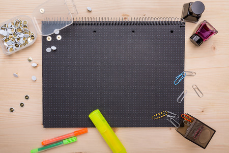 Office supplies arranged on a black notebook photo