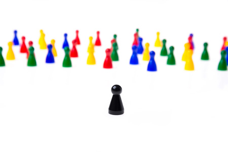misfit: Several game pawns in different colors on a white background. Stock Photo