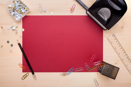 Different office objects, arranged on a wooden desk photo