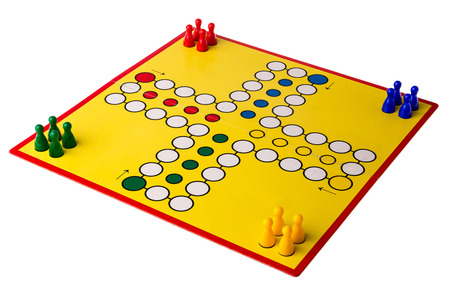 Yellow board game with four different colored pawns game on it.