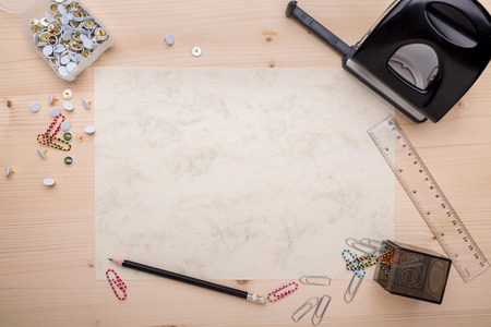 Office supplies arranged on a white piece of paper photo