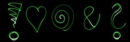 interrogation mark: Different flourescent symbols in green neon color Stock Photo