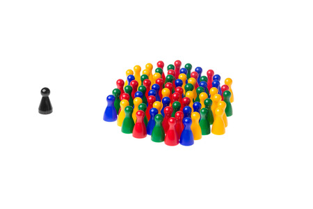lonesomeness: Several game pawns in different colors on a white background. Stock Photo