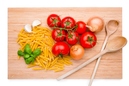 wood cut: Wooden cutting board with italian ingredients on it