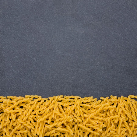 eating area: A plate of slate with some noodles on one end Stock Photo