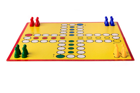 ludo: Board game with different colored game pawns on it