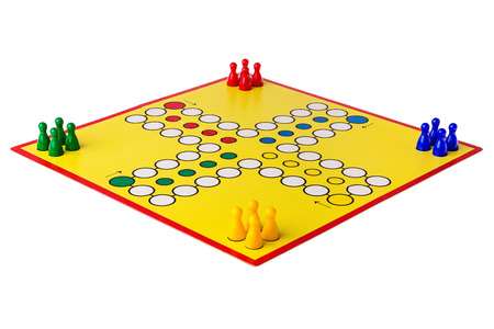ludo: Ludo boardgame arranged on a white background Stock Photo