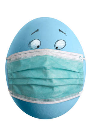 Large picture of an colored easter egg with drawn eyes and a mask.