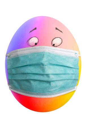 Large picture of an easter egg with rainbow colors, eyes and mask. Banco de Imagens