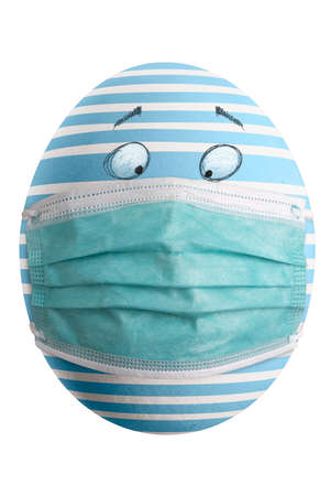 Large picture of an isolated easter egg with a stripes mask and eyes.