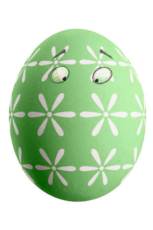 Large picture of an isolated easter egg with a floral pattern and eyes. Banco de Imagens