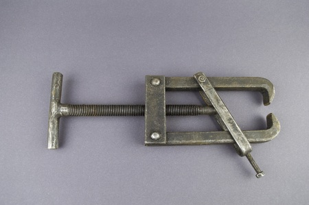 Metal bearing puller on a gray background with empty place for text.