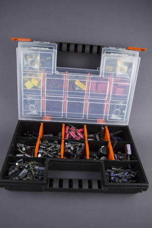 Electronic components capacitors stacked in a plastic folding case Stock fotó