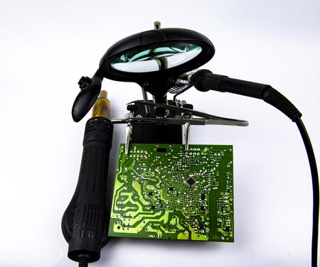 electronics repair - soldering iron, soldering station, magnifier. Refrigerator repair, washing machine repair, TV repair Stock fotó