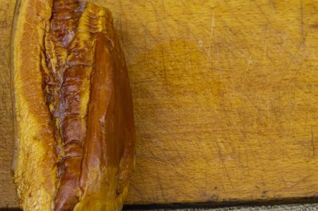smoked meat a whole piece on a cutting board, there is free space to fill