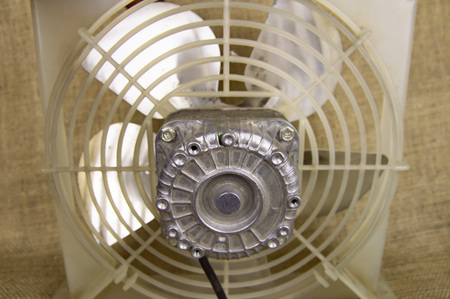 Rotating fan blowing cooling system - repair of refrigerators, air conditioners Stock Photo