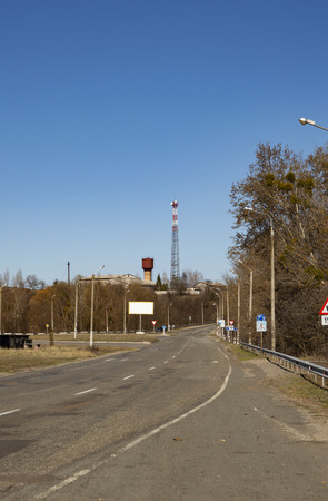 The tower of the mobile operator and the water tower nearby