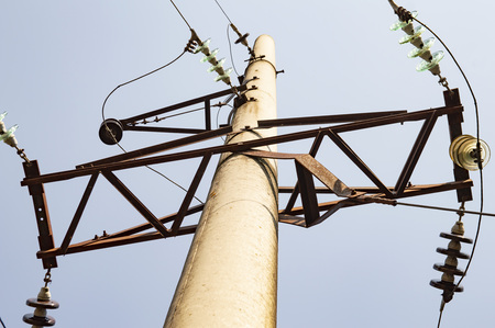 High-voltage line on a background of blue sky, sunny day