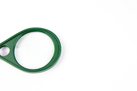 Magnifying glass - loupe on a white background. Green and orange colors.