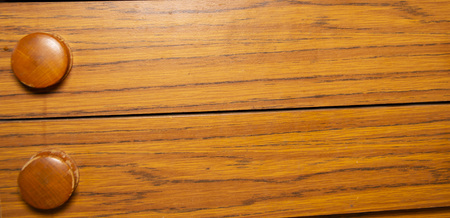 Wooden pull-out drawers with round wooden handles. Background, texture, place for text.