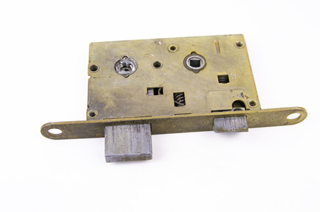 Disassembled door lock isolated against white background. Place for text.