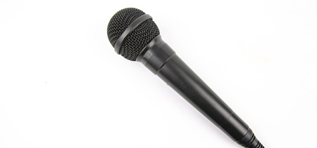 Microphone black on a white background. Place for text. Stock Photo