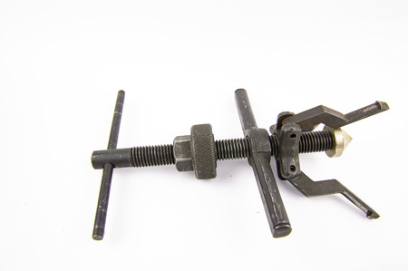 Bearing puller isolated on white background, metalwork tool. Place for text.
