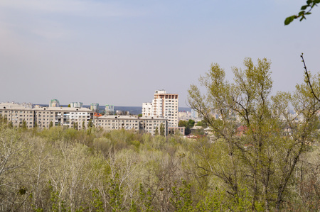 City skyline above trees from a bird's-eye view - background Stock Photo